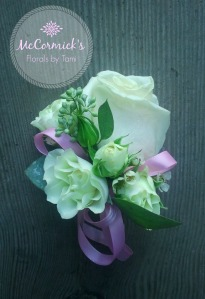 rose pin on corsage